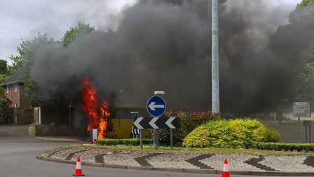 The coach on fire at the St Stephen's Hill roundabout. Picture: Jim Harper