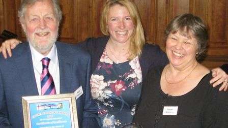 Hugh and Susan L'Estrange being presented with the Gold Award by Helen Frewin