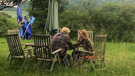 Steve Bray enters the frame as Boris Johnson and Carrie Symonds pose for a 'staged' photograph. (Lou