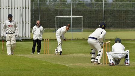 Shaun Asplin bowls for St Ives in their defeat to Wisbech. Picture: DUNCAN LAMONT