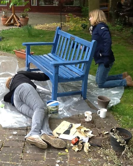 The Tesco team painting garden furniture.