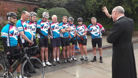 The cyclists being blessed by Sub Dean Richard Watson.