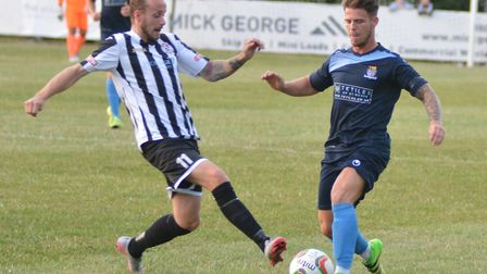Josh Dawkin (left) in action for St Ives Town against St Neots Town last season.