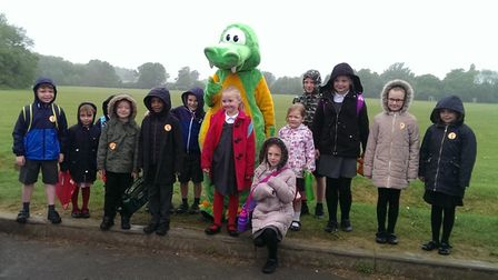 Pupils from Margaret Wix School with Buster the dinosaur.
