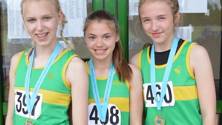 Hunts AC county champions are, from the left, Lizzy Harrison, Daisy Coulson-Bascombe and Ella Reed.