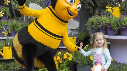 Three year old Sophie Fern meets Barry B Benson from the Bee Movie at Notcutts in Tunbridge Wells