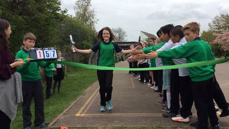 Crossing the finish line at the Camp School relay marathon.