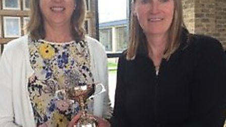 St Ives GC Lady Vice-Captain Claire Pendle (left) presents the Johnson Cup to Trish Whittamore.