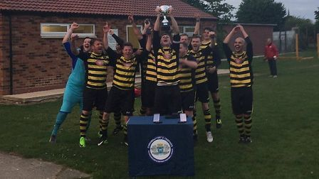 Ramsey Town celebrate their Peterborough & District League Division Two title triumph.