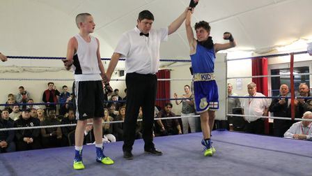 St Albans Boxing Club's Christian Bozia has his hand raised after victory over S Devlin of Kettering