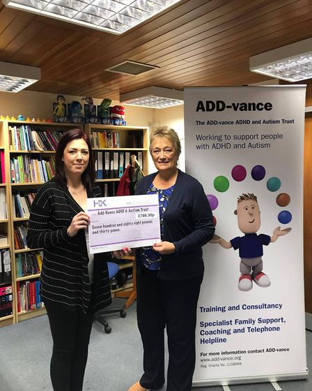 Handing over the cheque to the charity.