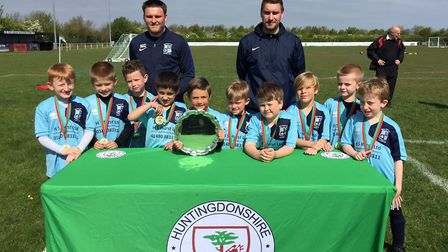 Godmanchester Town Under 7s, pictured with coaches Kieran Clemmence and Tim Allen, are Felix Bridge,