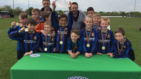 St Ives Rangers Under 10 Blue coaches Stephen Pope and Trevor Foster are pictured with players Rober