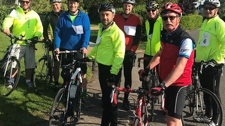 Peter Furmston,at the front in red, with cyclists from The Mordens on their charity ride for Wheels