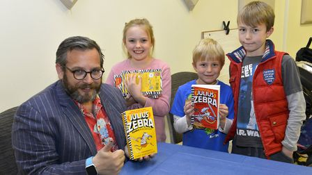 Pictured with Author Gary Northfield are Lily Johnston 8 and brothers Thomas 9 and Samuel 8 Gibbons.