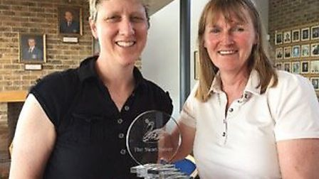 Michelle-Grubb Moore (left) is presented with then Swan Salver trophy by lady captain Trish Whittamo