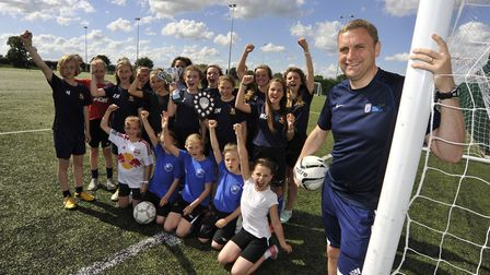 St Ives football coach Darren Marjoram, with some of his teams.