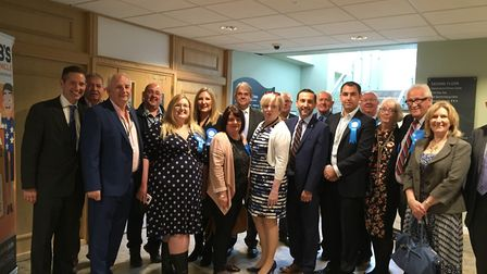 Conservative councillors members celebrate a successful election.