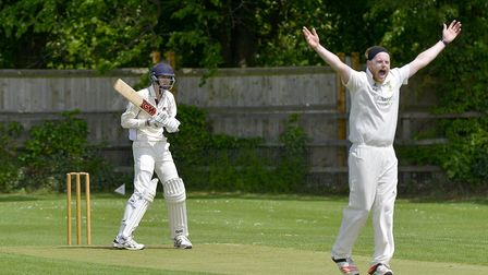 Mark Edwards celebrates one of his three wickets in Ramsey's triumph at Waresley. Picture: DUNCAN LA