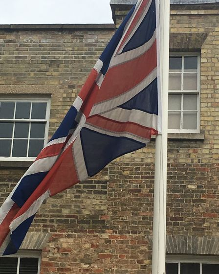 The flag at Huntingdonshire District Council is flying at half mast to remember those who lost their
