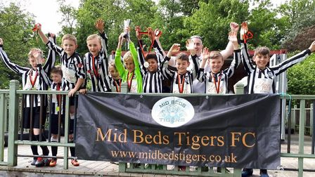 Buckden Vultures Under 10s celebrate winning their age group at the Mid Beds Tigers tournament.