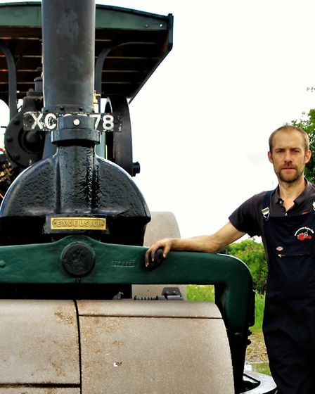 Alex Reid from Orwell, with his family''s 1902 Clayton & Shuttleworth Steam Roller. Picture: Clive P