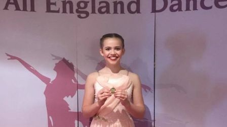 Ella Caloran from Royston with her gold medal after winning the All England Dance competition region