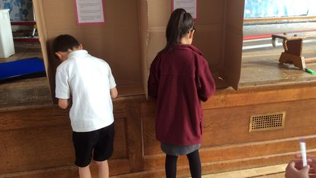 Voters making their decision. Photo: London Colney Primary School