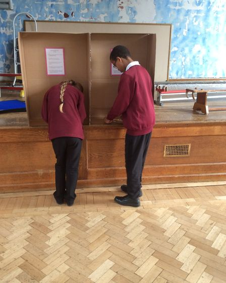 Another couple of voters making their choice. Photo: London Colney Primary School