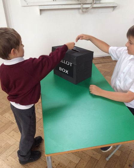 A voter dropping their vote in the ballot box. Photo: London Colney Primary School