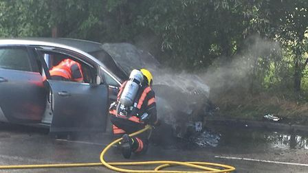 Fire crews tackle car blaze in Little Paxton