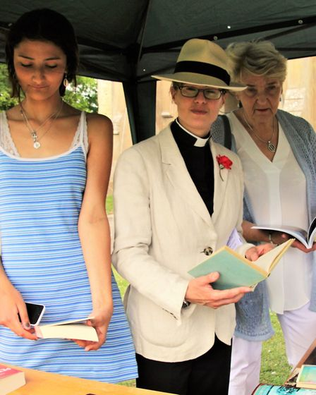 Ottilie Majumdar, Rev Lizzie Shipp, and Joy Hart browsing on the book stall. Picture: Clive Porter