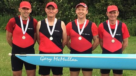 The St Ives Rowing Club Masters 'D' crew show off their silver medals.