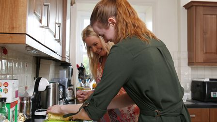 Herts Advertiser reporter Franki Berry receives a cooking lesson from Masterchef contestant Lyndsay