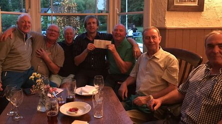 The 'OId Gits' from Therfield's Fox and Duck pub present their £125 charity cheque to Parkinson's UK