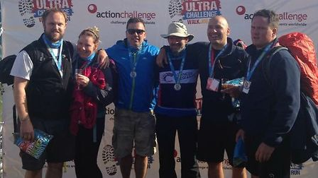 Liam and Donna Geraghty with brothers Mark, Neil and Luke Rigby and Peter Mumford after completing l