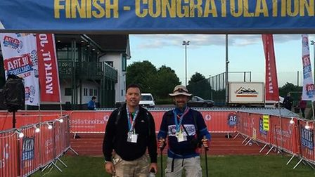 Neil and Luke Rigby at the finish line of last year's race.
