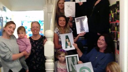 Acorns Nursery celebrating its outstanding Ofsted report.
