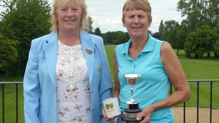 Cambs & Hunts Ladies County Golf Association president Jacquie Richardso (left) presents Audrey Nico