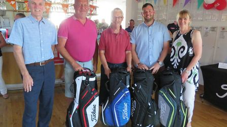 St Ives (Hunts) Golf Club captain Stuart Grey (left) and lady captain Trish Whittamore (right) are p