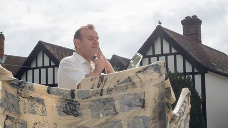 Melbourn barber Tony Perretta re-enacts the opening scenes of 'Ulysses' by shaving at the top of a M