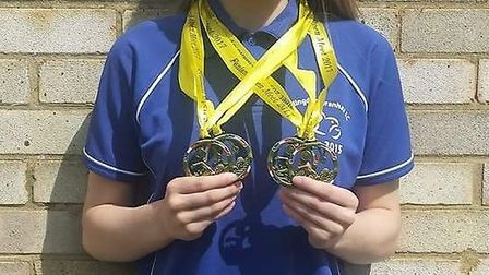 Skie Wallace of Huntingdon Piranhas with her gold medals.