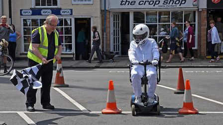 Mobility scooter Grand Prix in St Ives - The Stig with Councillor Nick Dibben.