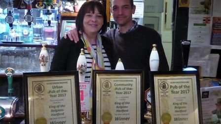 Owners Jane and Matt Spicer of the King of the Belgians with their CAMRA awards
