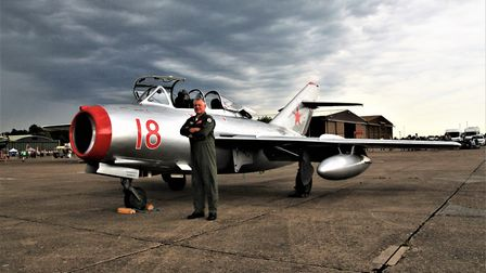 Pilot Wayne Fuller with a MIG 15 UTI. Picture: Clive Porter