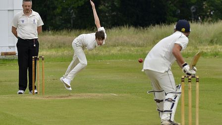 Ramsey 3rds bowler Tommy Hodgson sends down a delivery during their defeat to Sawtry. Picture: DUNCA