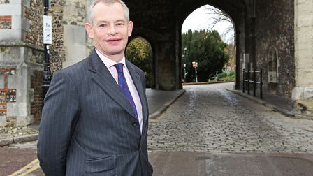 Headmaster of St Albans School Jonathan Gillespie in front of the Abbey Gateway.