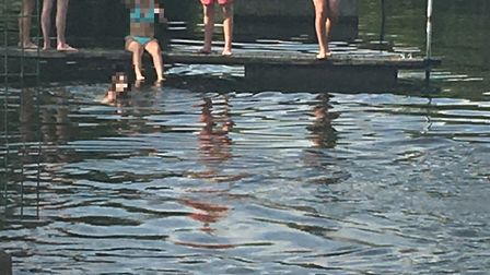 Youngsters jumping into the River Great Ouse in Eaton Socon.