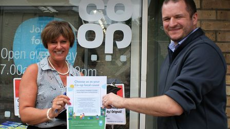 Home-Start's Tracy Aggett and Melbourn Co-op manager Steve Carr. Picture: Courtesy of HSRSC