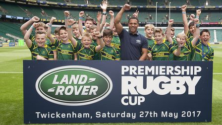 Huntingdon Under 12s are pictured with former England star Jason Robinson during their memorable vis